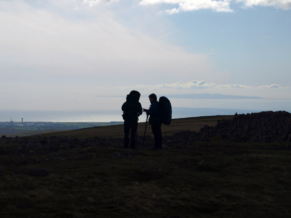 Backpackers consilt the map on Caw Fell