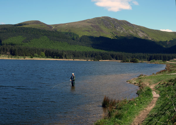 Fly-fisherman enjoying the sunshine and sport of Cogra Moss Reservoir
