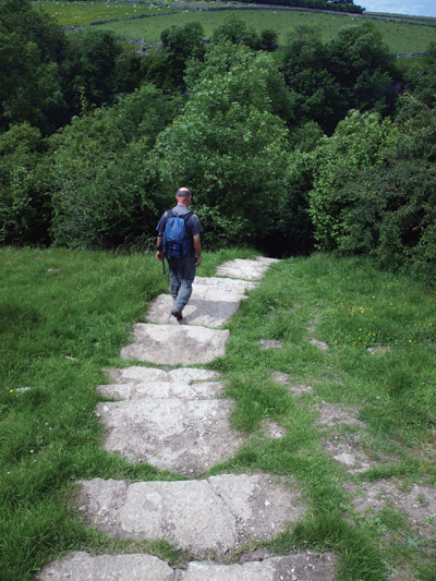 The footpath enters Cales Dale via a flight of flag steps