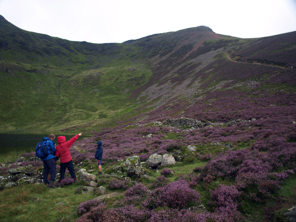 Walkers consider the final climb from Bleaberry Tarn to the summit