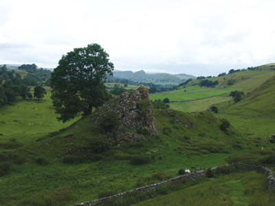 Limestone outcrop at Pilsbury Castle mimmicking the distant shapely peaks of Dowel Dale