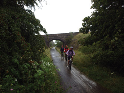 Cheery cyclists on a damp ol'day on the Tissington Trail