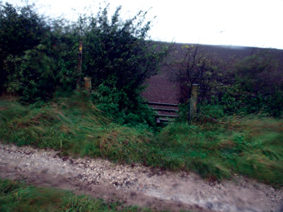 Stile where path to Aleck Low leaves the farm track off the High Peak Trail