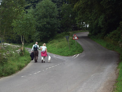 Walkers on road above Biggin Dale