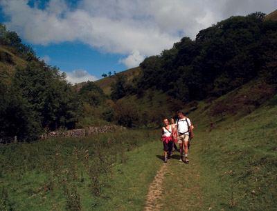 Walkers in dry valley behind Wetton Mill