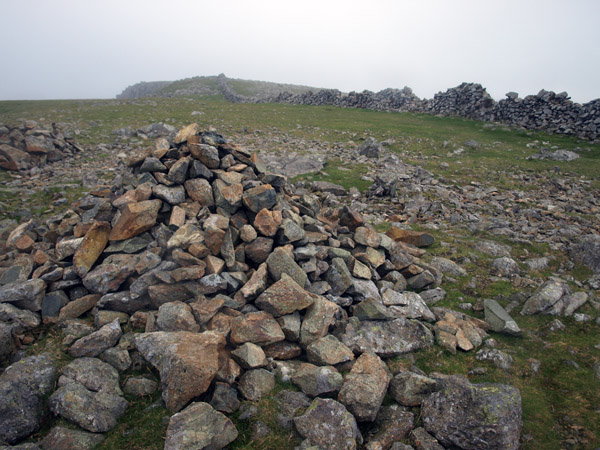 Large cairn at the angle of the ridge wall where the path connection to Steeple departs, frequently accepted as the summit by more casual visitors